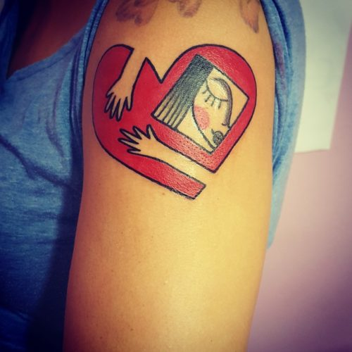 Tatuaggio abbraccio cuore Modena